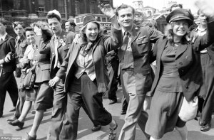 027C479B0000044D-3071796-This_happy_group_marches_through_the_streets_in_their_military_u-a-10_1431005166110